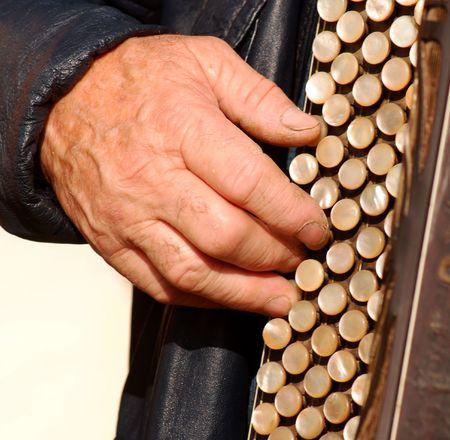 playing folk: Old man play retro accordion Stock Photo
