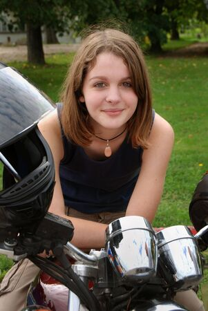 Teenage girl on the motorcycle Stock Photo - 2307733