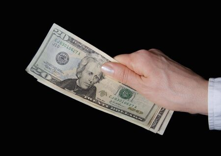 Woman hand with dollar banknote in close up photo