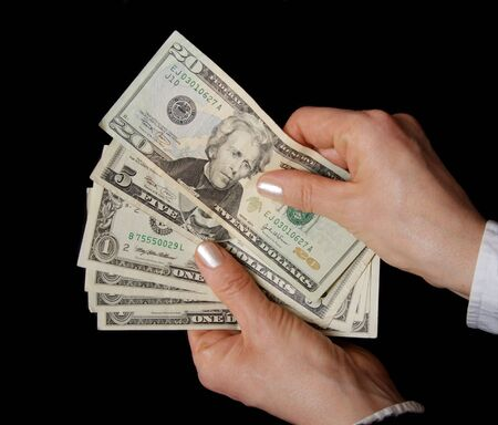 Woman hands with dollar banknote in close up Stock Photo - 2678419