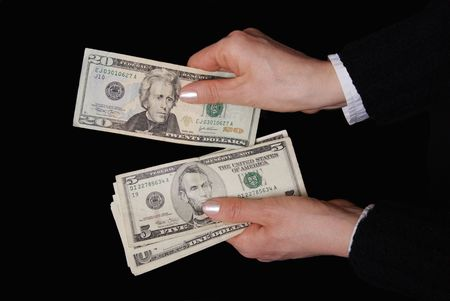 Woman hands with dollar banknote in close up photo