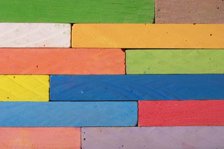 Heap of colorful chalks in close up photo