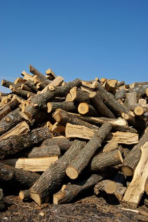 wood heating: Stock of wood for heating over blue sky