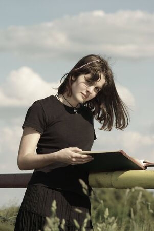 Portrait of a teenage girl  outside with book Stock Photo - 3049327