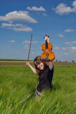 woman violin: Teenage girl with violin  in wheat field