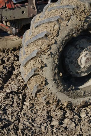 Muddy dirty tractor tire in close up photo