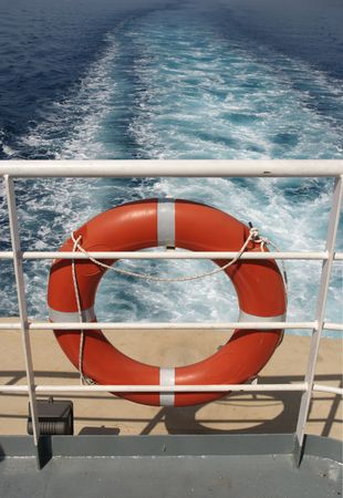 ferryboat: Red rescue belt on a traveling ship Stock Photo