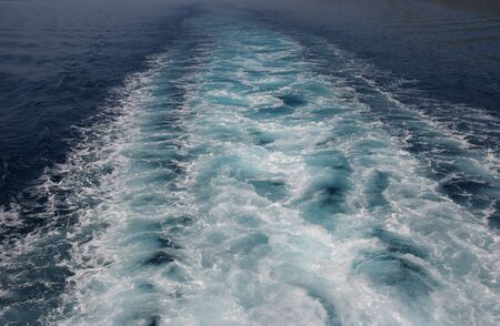 churning: Mediterranean sea water churning behind a ship Stock Photo
