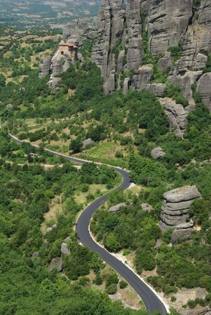 nicolas: Mountain road With Monastery of Saint Nicolas,Meteora, Greece, Thessaly Stock Photo