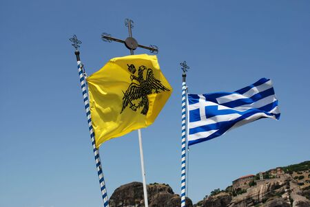 thessalia: Byzantine and Greek flying flags and cross over blue sky