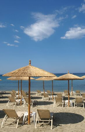 Seaside in Greece in  summer with umbrella