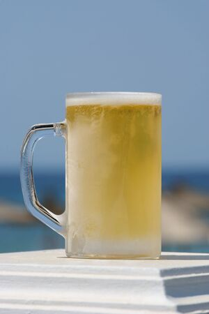 Frozen glass with light beer Stock Photo - 3479778