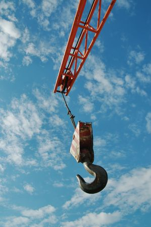Hook and crane over blue sky and clouds Stock Photo