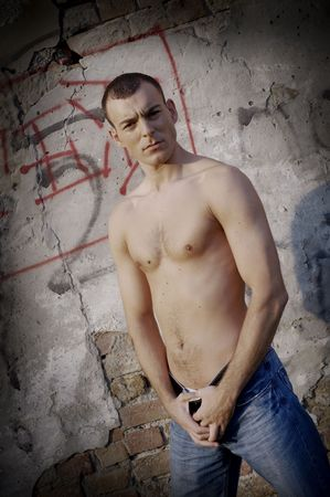 Shirtless muscular male model in front of the wall Stock Photo - 3760556