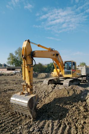Working  with excavator on yellow  ground Stock Photo