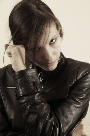 Portrait of a young caucasian girl  with leather jacket photo