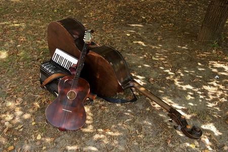 Three music instrument on the ground photo