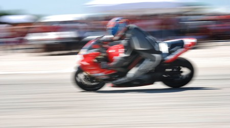 Motorcycle races,  motorcycle in full speed,  blur, panning photo