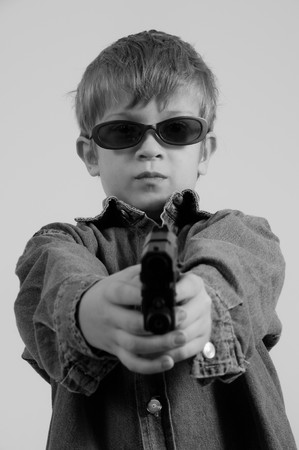 Young Caucasian boy with gun toy Stock Photo - 4406342