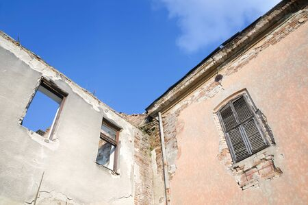detai: Detai of old ruined house with blue sky