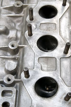 benzin: Part of car engine, holes for exhaust at head  Stock Photo