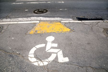 Painted sign for handicapped   on the street photo