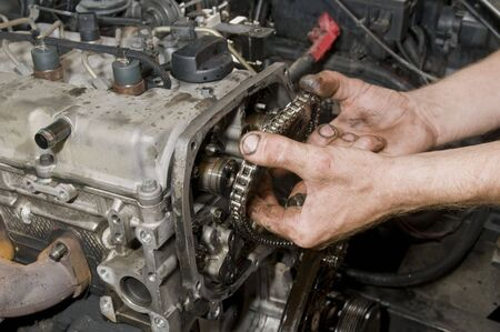 Repairing of diesel engine close up of worker hands Stock Photo