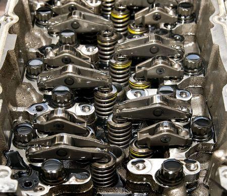benzine: Close up of parts in engine head 4 valve per cylinder system