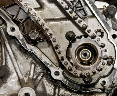 Close up of car engine camshaft gear and chain photo