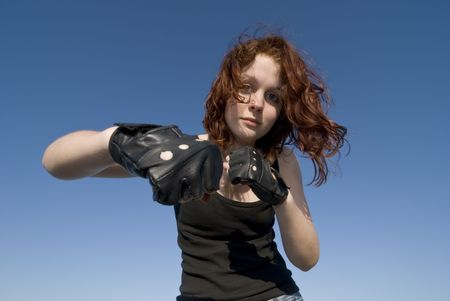 Red hair teenage girl gesturing with gloves on hands photo