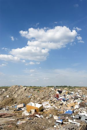 Different waste  over blue sky and clouds Stock Photo - 5193353