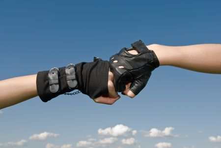 Two girls hands with gloves head on photo