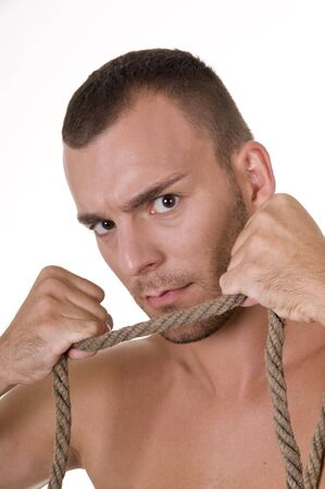 Studio shoot of young caucasian man with rope photo