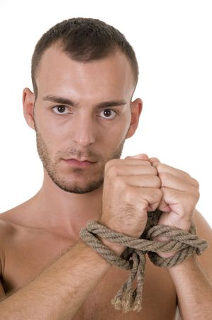 Studio shoot of young caucasian man with tied hands photo