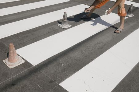 Preparing for  spraying of pedestrian crosswalk at a street photo