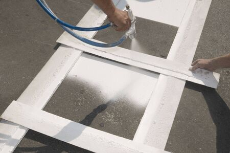 Hand spraying of pedestrian crosswalk at a street photo