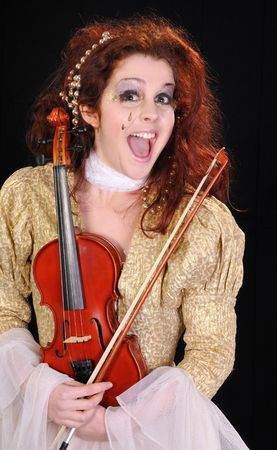 Young  girl holding violin with  artistic make up photo
