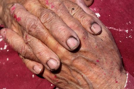 Close up of old worker hands photo