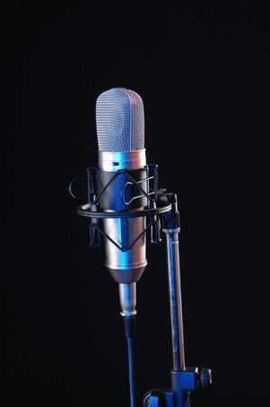 Studio microphone for sound recording on black background Stock Photo - 6954259