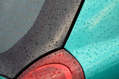 Part of a modern car with rain drops Stock Photo - 7144919