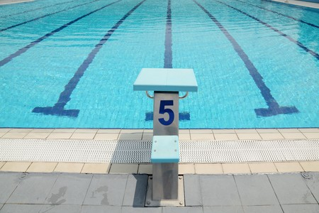 starting line: Detail from open air sports competition swimming pool, starting place