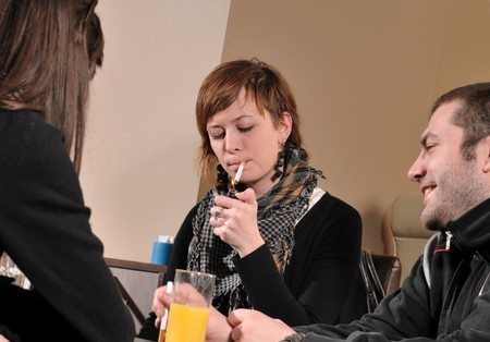 cigarette lighter: Young people sitting in cafe and talking