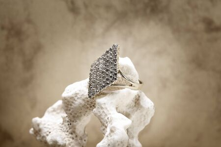 Close up photo of diamond ring on coral photo