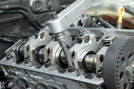 Socket wrench and camshaft of  car engine in close up Stock Photo - 7886321