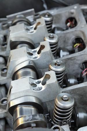 Repairing of modern diesel engine closeup of camshaft photo