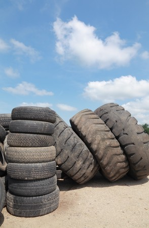 Heap of old truck tires prepared for recycling photo