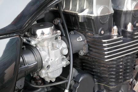benzin: Close up of motorcycle engine, carburetor and cylinder head