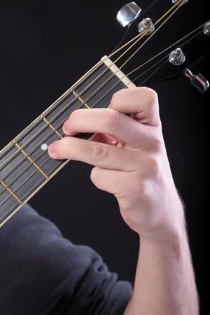 accord: Human hand taking  D-minor accord at guitar