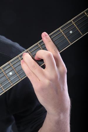 accord: Human hand taking  A-major accord at guitar Stock Photo
