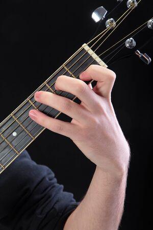 accord: Human hand taking  C-major accord at guitar Stock Photo